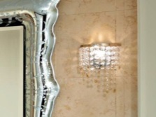 Crystal wall lamp in the bathroom