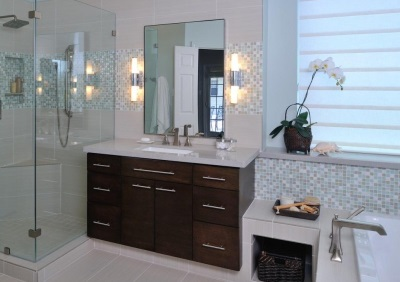 Location sconces on either side of the mirror in the bathroom