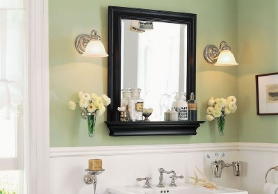 Mirror with shelf and lighting in the bathroom
