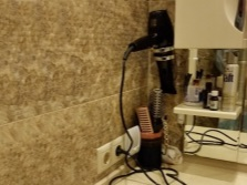 Varieties holders to hairdryers in the bathroom
