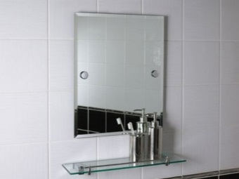 Installing mirror with shelf in the bathroom on the screws