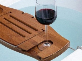 Shelf for a glass of wine in the bath