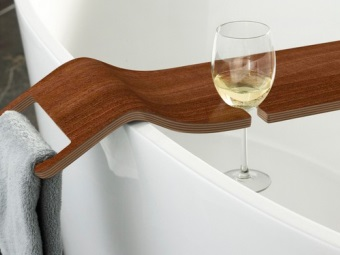 Wooden shelf for glasses in bath