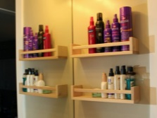 Shelves for spices in the bathroom .