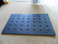 Mat with holes to drain water