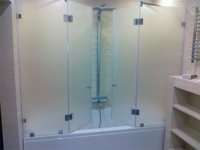 Installed glass enclosure for baths