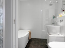 The interior of a small bathroom , room with WC in white