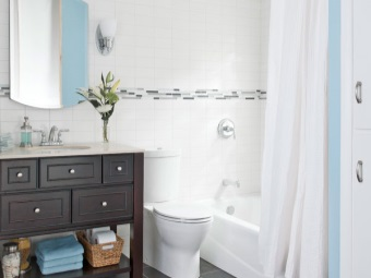Spacious floor pedestal black color with built-in sink in a white interior bathroom , room with WC