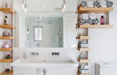 Wooden shelves in white interior bathroom with WC