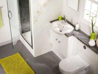 Plumbing is located on one wall in a small bathroom , room with WC