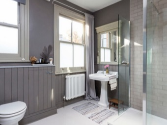 Ottdelka bathroom interior room with ceramic toilet Litke , chipboard and plaster in gray