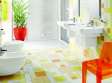 Bright interior of the bathroom , room with toilet in the green- yellow- white color scheme,