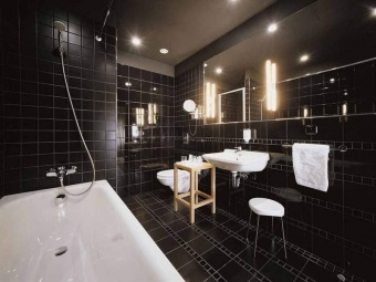 Combined with black toilet bathroom with white sanitary ware