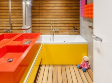 Yellow bath, orange shells in the interior of the bathroom , room with WC