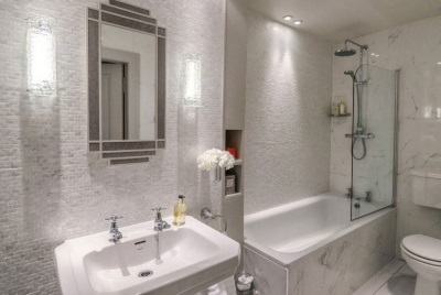 Zoned lighting in the interior of the bathroom , room with WC