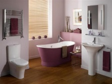Lilac bath in white and purple interior of the bathroom , room with WC