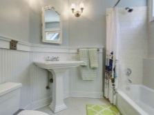 Wall sconces to illuminate the mirrors in the interior of the bathroom , room with WC