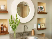 Small niches with wooden shelves in the bathroom wall near the mirror
