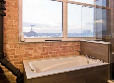 Bathroom with brick walls , large windows , and not hidden in the loft-style communication