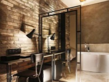 The brick and plaster walls in the bathroom in the loft