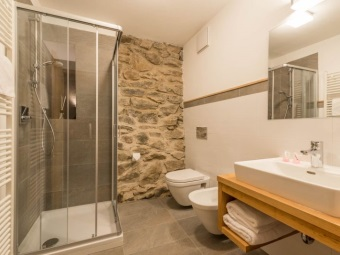 White and stone walls in the bathroom in chalet style,
