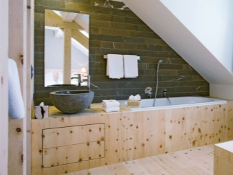 Wooden surfaces in the bathroom in chalet style,