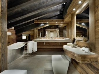 Natural stone slabs on the floor , wooden walls in the bathroom in a chalet -style