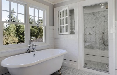 Interior bathroom in a Scandinavian style and White bath and shower