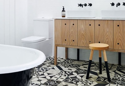 Bathroom in Scandinavian style- white walls and national patterns on the floor