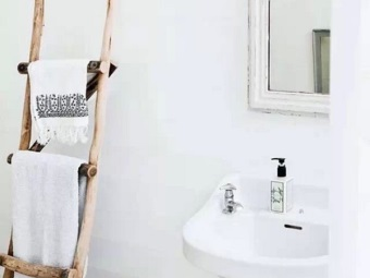 A homemade ladder for drying towels in the bathroom in the Scandinavian style