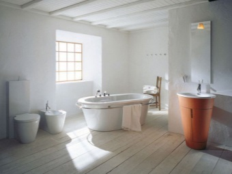 White and orange bath sinks for the bathroom in the Scandinavian style