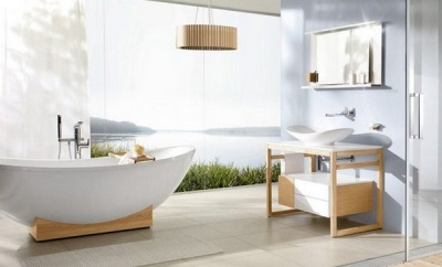 White oval bath in a wooden frame to a set of bathroom furniture in the Scandinavian style