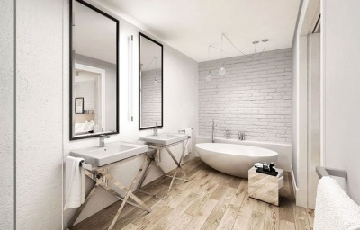 Mirrors in wooden frame , wooden desk under the sink and the floor made ​​of wood - the characteristics of the Scandinavian bath