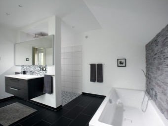 The walls of the bathroom in the high -tech ceramic tiles , plaster and tiles imitating stone