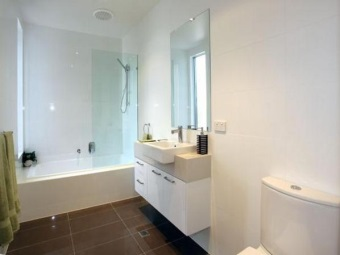 Rectangular white ceramic tile for wall decoration bathroom in style hi - tech and large dark tile on the floor
