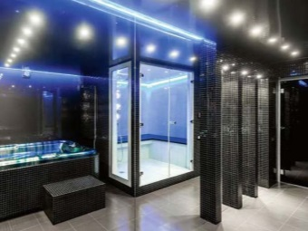 Bright spotlights in a dark bathroom in style hi -tech
