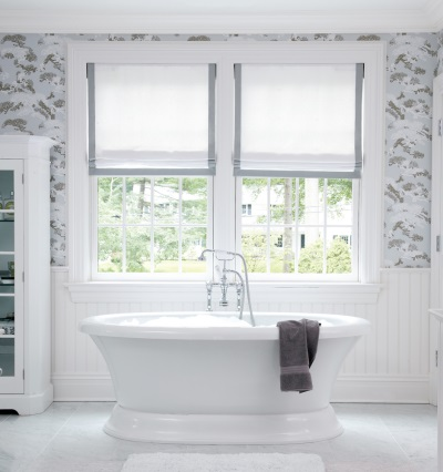 Grey bathroom with white and window