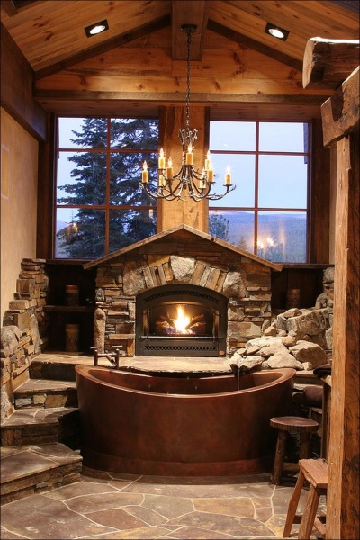 Bathroom with a fireplace and a tree