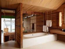 Bathroom decorated with natural wood