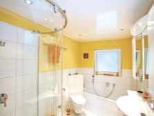 Bathroom with a glossy ceiling