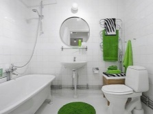 White bathroom with bright accents in the form of accessories