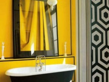 Yellow bathroom with black decor elements