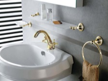 Grey bathroom with gold-plated accessories