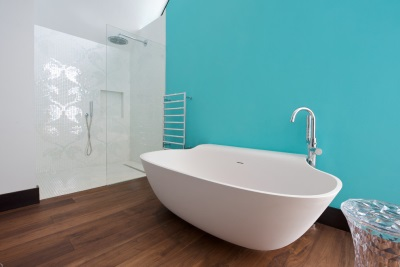 Turquoise bathroom and wooden floor
