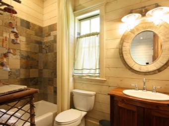 Round oval mirror in a bathroom in a country style