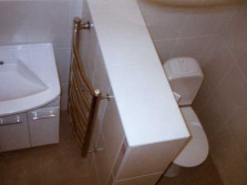 Plasterboard partitions between toilet and wash basin