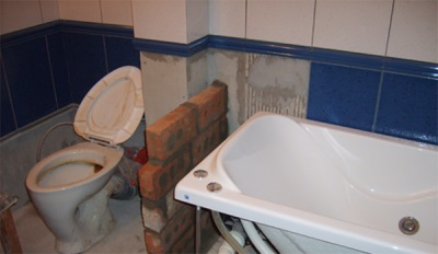 The partition in the bathroom of bricks