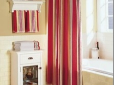 Red curtains in a white bath