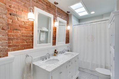 Brick wall in white bathroom