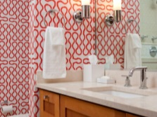 Red and white wallpaper in the bathroom